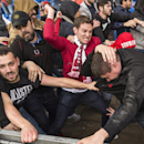 FILE - In this Wednesday, May 18, 2016 file photo, groups of fans from Liverpool, right, and Sevilla, start fighting ahead of the soccer Europa League final between England's Liverpool FC and Spain's Sevilla Futbol Club at the St. Jakob-Park stadi