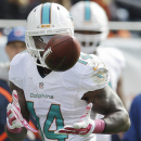 Miami Dolphins wide receiver Jarvis Landry (14) catches a pass from quarterback Ryan Tannehill during the first half of an NFL football game against the Chicago Bears Sunday, Oct. 19, 2014 in Chicago The Associated Press