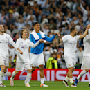 Real Madrid's Gareth Bale, left, and Cristiano Ronaldo, right, celebrate with their teammates at the end of the Champions League semifinal second leg soccer match between Real Madrid and Manchester City at the Santiago Bernabeu stadium in Madrid, Wedn
