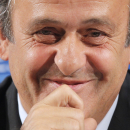 FILE - In this Feb. 22, 2014 file photo, UEFA President Michel Platini gestures during a press conference, one day prior to the UEFA EURO 2016 qualifying draw in Nice, southeastern France. Michel Platini will run for FIFA president and plans to announce his intentions this week. Two officials familiar with Platini's plans tell The Associated Press that the FIFA vice president has made a decision to try to succeed Sepp Blatter. The officials spoke on condition of anonymity because Platini has not announced his candidacy. (AP Photo/Lionel Cironneau, File)