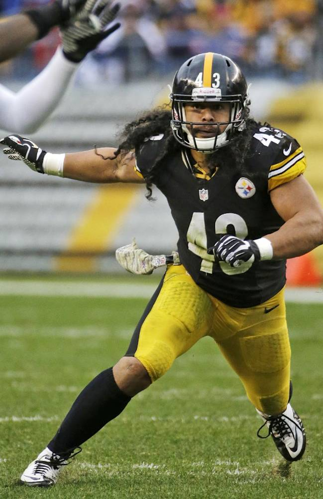 In this Nov. 10, 2013 file photo, Pittsburgh Steelers' Troy Polamalu (43) drops into coverage during the second half of an NFL football game against the Buffalo Bills, in Pittsburgh. The Steelers safety is back to his freewheeling self for Pittsburgh, which has won three straight to get back into the playoff race