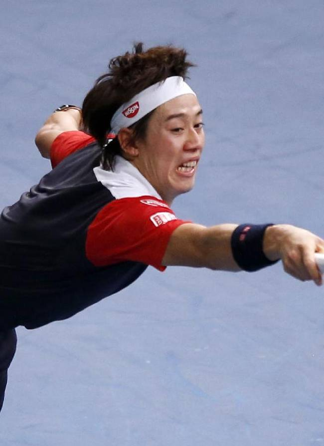 Kei Nishikori of Japan returns the ball to Richard Gasquet of France, during their round of eight match, at the Paris Masters tennis at Bercy Arena in Paris, France, Thursday, Oct. 31, 2013