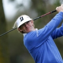 U.S. golfer Brandt Snedeker hits a drive off the 11th tee of the south course at Torrey Pines during first round play at the Farmers Insurance Open in San Diego, California January 24, 2013. REUTERS/Mike Blake