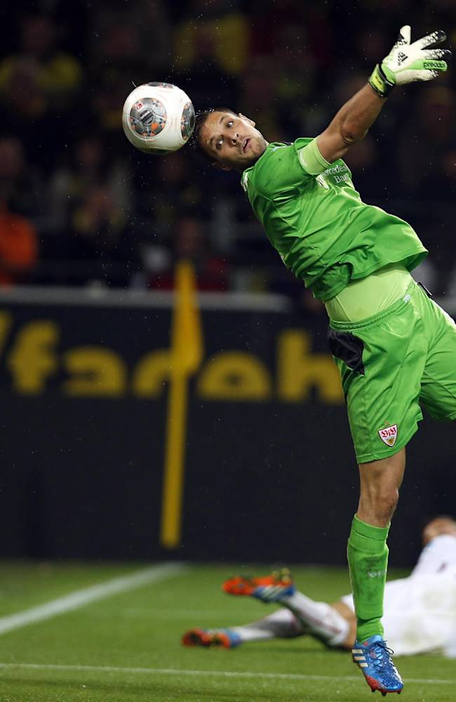 Stuttgart goalkeeper Sven Ulreich misses the chance to stop a goal, during the German first division Bundesliga soccer match between  BvB Borussia Dortmund and VfB Stuttgart  in Dortmund, Germany, Friday, Nov. 1, 2013