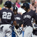 New York Yankees' Eduardo Nunez, right, is congratulated by Jacoby Ellsbury after hitting a two-run home run off Toronto Blue Jays' Todd Redmond during the third inning of an exhibition baseball game in Dunedin, Fla., on Sunday, March 2, 2014 The Associat