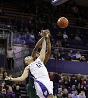 Washington's Andrew Andrews (12) and Mississippi Valley State' James Currington collide in the first half of an NCAA men's basketball game, Friday, Dec. 27, 2013, in Seattle. (AP Photo/Elaine Thompson)