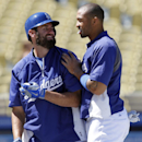 Los Angeles Dodgers' Scott Van Slyke, left, talks with teammate Matt Kemp as they prepare for the Dodgers' baseball game against the San Francisco Giants on Sunday, April 6, 2014, in Los Angeles The Associated Press