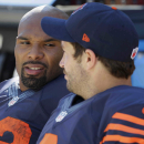 Chicago Bears running back Matt Forte (22) talks to quarterback Jay Cutler (6) on the sideline bench in the second half of an NFL football game Sunday, Sept. 28, 2014, in Chicago. The Packers won 38-17. The Associated Press
