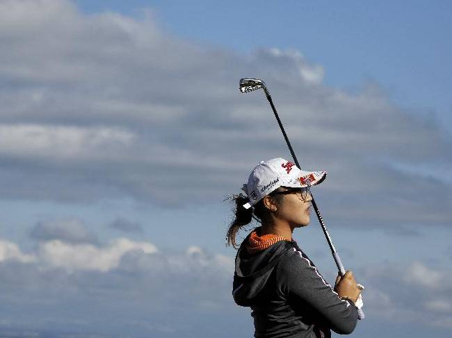 Lydia Ko of New Zealand follows the ball after playing on the 17th hole during the first round of the Evian Championship women's golf tournament in Evian, eastern France, Friday, Sept. 13, 2013