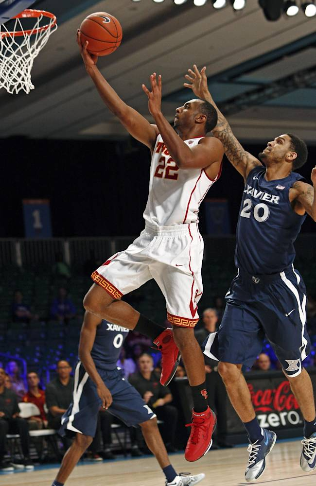 Southern California's Byron Wesley, left, drives for a layup as Xavier's Justin Martin defends during the second half of an NCAA college basketball game in Paradise Island, Bahamas, Saturday, Nov. 30, 2013. USC won 84-78