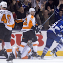 Toronto Maple Leafs' Joffrey Lupul (19) celebrates after scoring the game winning overtime goal as Philadelphia Flyers' Mark Streit (32) looks over at Flyers' Vincent Lecavalier during an NHL hockey game, Saturday, March 8, 2014 in Toronto The Associated