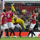 Liverpool's Mario Balotelli, centre left, attempts to score with an overhead kick during the English Premier League soccer match between Manchester United and Liverpool at Old Trafford Stadium, Manchester, England, Sunday Dec. 14, 2014
