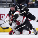 Los Angeles Kings defenseman Matt Greene, top, lays on the back of New Jersey Devils center Adam Henrique as they battle for the puck during the second period of an NHL hockey game, Wednesday, Jan. 14, 2015, in Los Angeles The Associated Press