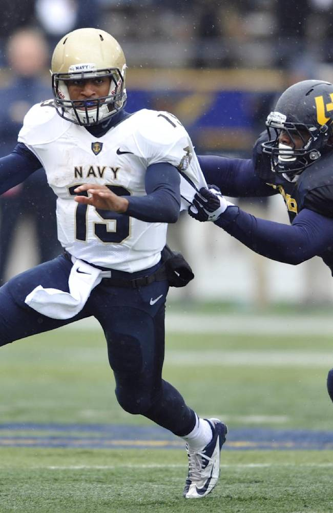 In this Oct. 19, 2013 file photo, Toledo defensive tackle Treyvon Hester, right, chases Navy quarterback Keenan Reynolds during an NCAA college football game in Toledo, Ohio. Reynolds has enjoyed a sensational sophomore season, running for 1,124 yards and 26 touchdowns. Perhaps the only way it can get better is if he can lead the Midshipmen to their 12th straight win over Army this Saturday in Philadelphia