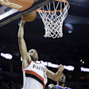 Portland Trail Blazers forward Nicolas Batum, left, from France, goes to the hoop past New York Knicks guard Iman Shumpert during the second half of an NBA basketball game in Portland, Ore., Monday, Nov. 25, 2013. Batum scored 23 points as they beat the