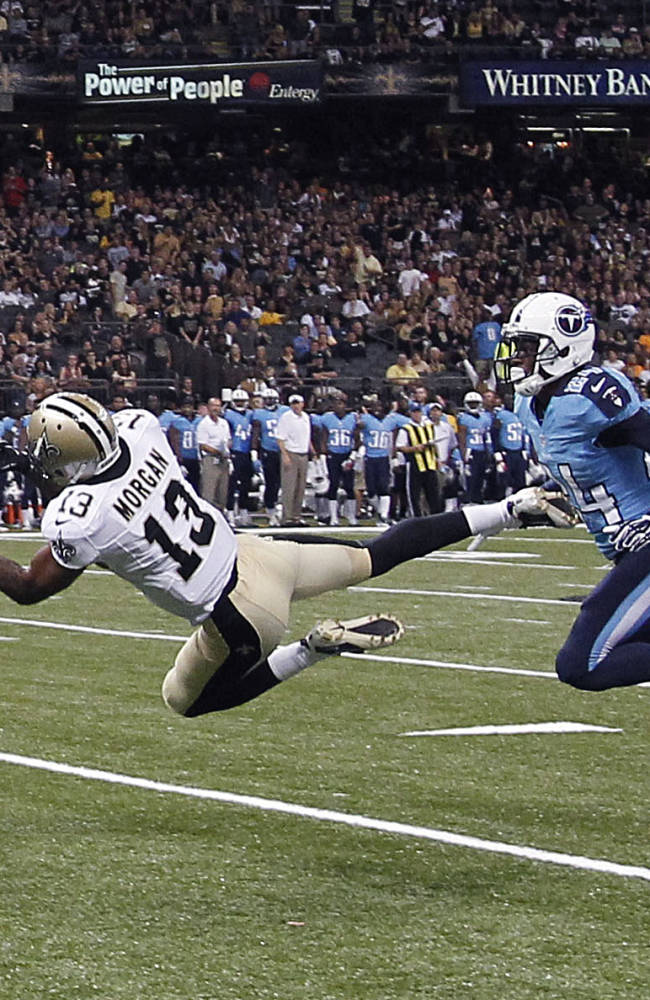 In this Aug. 15, 2014, file photo, New Orleans Saints wide receiver Joe Morgan (13) pulls in a pass reception in the first half of an NFL preseason football game against the Tennessee Titans in New Orleans. Morgan's two long catches in New Orleans' most recent preseason contest offered the first real sign since training camp began that the receiver can still be the deep threat he was before a serious knee injury wiped out his 2013 campaign