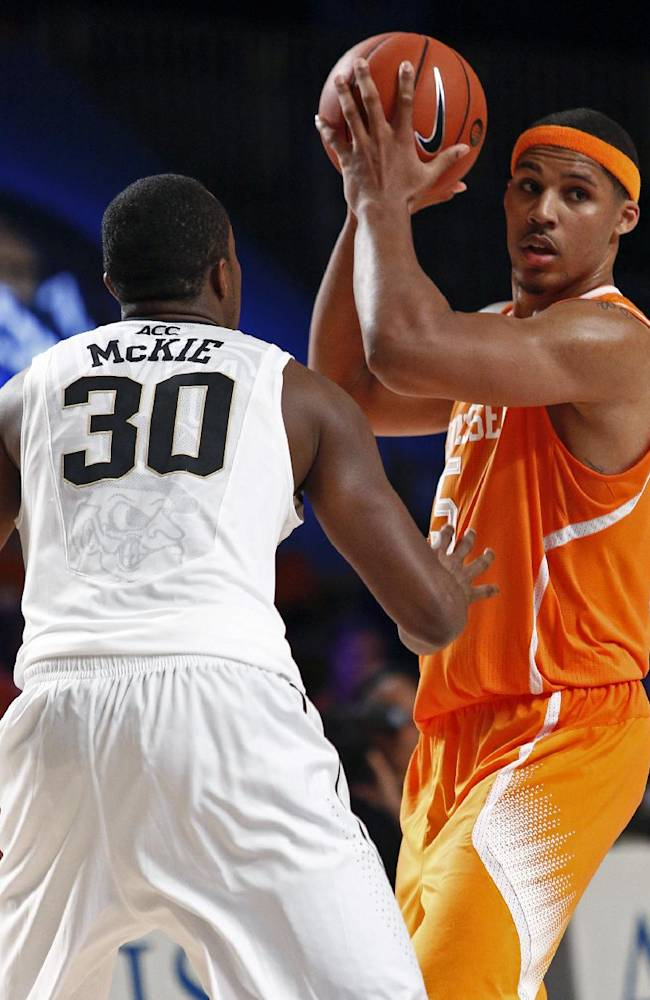 Tennessee's Jarnell Stokes, right, searches for a teammate to pass the ball to as Wake Forest's Travis Mckie defends during the during the second half of an NCAA college basketball game in Paradise Island, Bahamas, Saturday, Nov. 30, 2013. Tennessee won 82-63