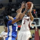 Alabama's Jasmine Robinson (3) attempts a shot over Kentucky's Bria Goss (13) during the first half of their NCAA women's college basketball game, Sunday, Jan. 6, 2013, in Tuscaloosa, Ala. (AP Photo/Jason Harless)
