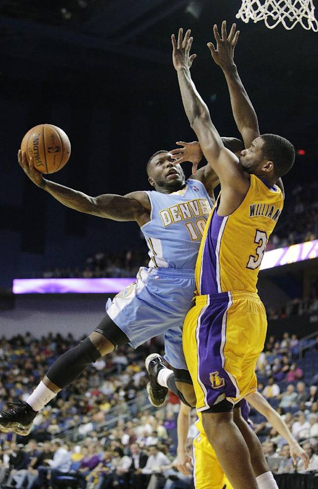 Denver Nuggets' Nate Robinson, left, puts up a shot against Los Angeles Lakers' Shawne Williams in the second half of an NBA preseason basketball game on Tuesday, Oct. 8, 2013, in Ontario, Calif. The Lakers won 90-88