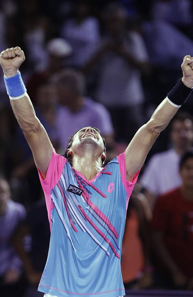 David Ferrer of Spain, celebrates after defeating Andreas Seppi of Italy, 6-3, 6-2 at the Sony Open tennis tournament, Sunday, March 23, 2014, in Key Biscayne, Fla