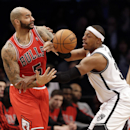Brooklyn Nets' Paul Pierce, right, knocks the ball away from Chicago Bulls' Carlos Boozer during the first half of an NBA basketball game Monday, March 3, 2014, in New York The Associated Press