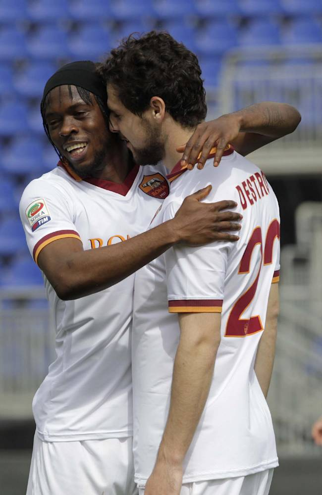 Roma's Mattia Destro, right, celebrates with teammate Gervinho after scoring during a Serie A soccer match between Cagliari and Roma in Cagliari, Italy, Sunday, April 6, 2014