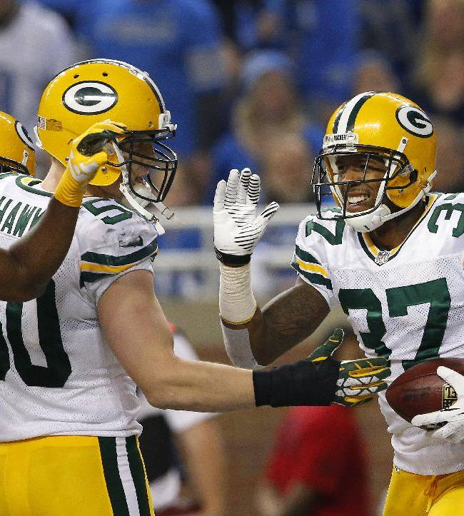 Green Bay Packers cornerback Sam Shields (37) celebrates his interception during the third quarter of an NFL football game against the Detroit Lions at Ford Field in Detroit, Thursday, Nov. 28, 2013