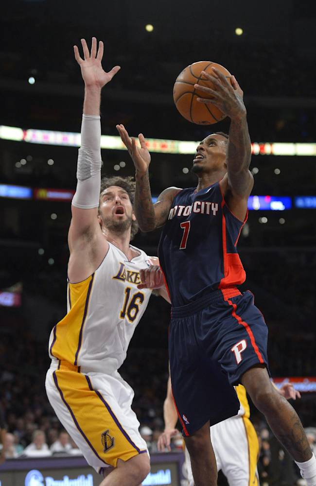 Detroit Pistons guard Brandon Jennings, right, puts up a shot as Los Angeles Lakers center Pau Gasol, of Spain, defends during the second half of an NBA basketball game Sunday, Nov. 17, 2013, in Los Angeles