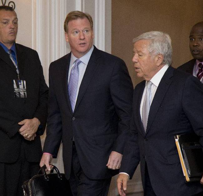 NFL Commissioner Roger Goodell, second from left, and New England Patriots football team owner Robert Kraft, right foreground, arrive for the NFL fall meeting in Washington, Tuesday, Oct. 8, 2013