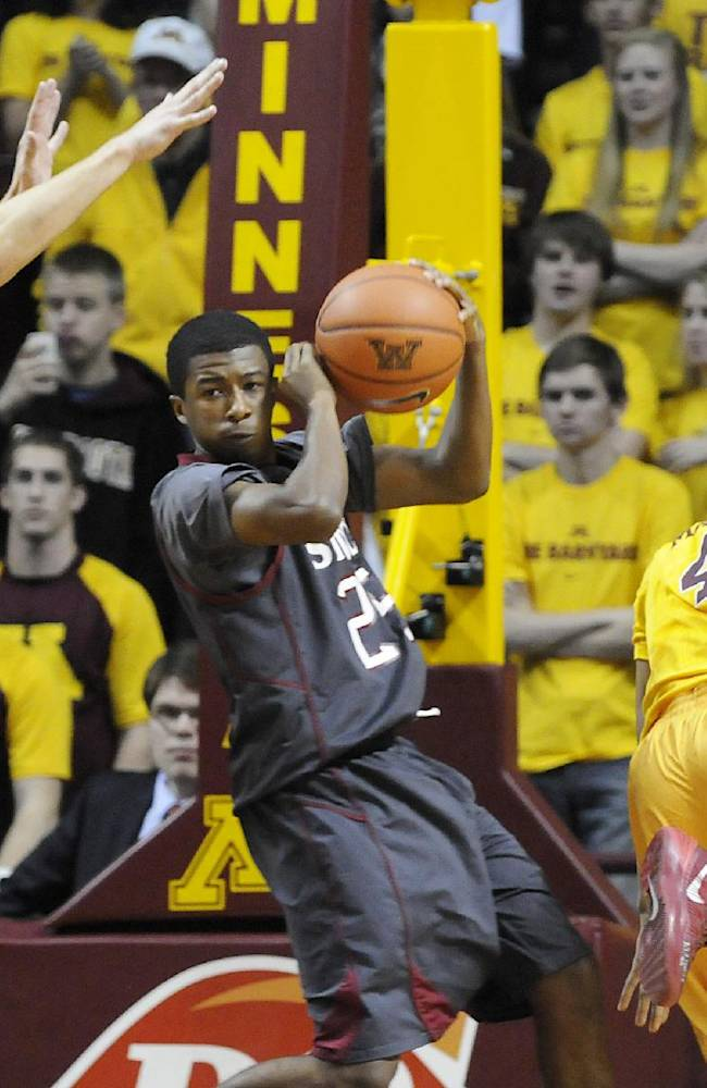 Cardinal Stritch's Teadric Anderson, center, looks to pass around Minnesota's Oto Osenieks, left, and DeAndre Mathieu in the first half of an exhibition NCAA college basketball game in Minneapolis, Friday, Nov. 1, 2013