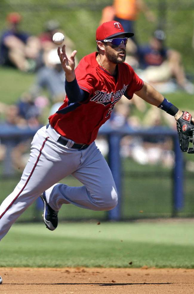 Minnesota Twins third baseman Trevor Plouffe throws to second base to force out Tampa Bay Rays Desmond Jennings to end the third inning of an exhibition baseball game in Port Charlotte, Fla., Tuesday, March 11, 2014