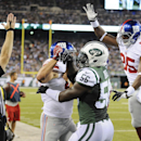 New York Giants tight end Daniel Fells (85) congratulates fullback Henry Hynoski (45) in front of New York Jets inside linebacker Demario Davis (56) after Hynoski scored a touchdown in the third quarter of a preseason NFL football game, Friday, Aug. 22, 2