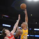 Los Angeles Lakers center Robert Sacre puts up a shot as Houston Rockets center Omer Asik, of Turkey, defends during the first half of an NBA basketball game Wednesday, Feb. 19, 2014, in Los Angeles The Associated Press