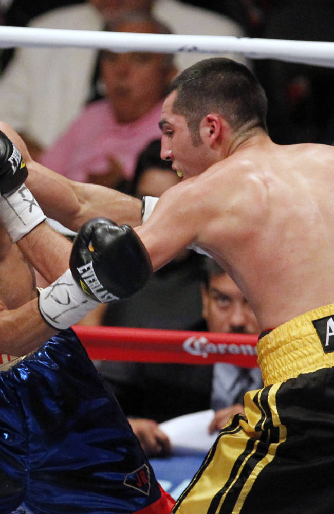 Oscar Cantu, right, fights Joseph Rios during a boxing bout Thursday, Aug. 7, 2014, in Corpus Christi, Texas. Cantu won the match by decision