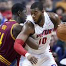 Detroit Pistons center Greg Monroe (10) drives against Cleveland Cavaliers center Henry Sims (14) during the first half of an NBA basketball game Wednesday, Feb. 12, 2014, in Auburn Hills, Mich The Associated Press