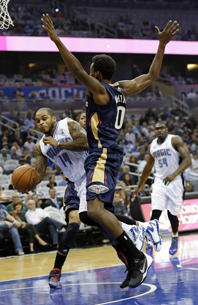 Orlando Magic's Jameer Nelson (14) passes the ball around New Orleans Pelicans' Al-Farouq Aminu during the first half of an NBA basketball game in Orlando, Fla., Friday, Nov. 1, 2013