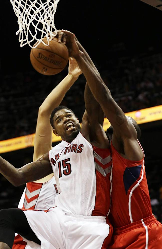 Toronto Raptors forward Amir Johnson (15) battles Atlanta Hawks power forward Paul Millsap, right, for a rebound in the first half of an NBA basketball game Friday, Nov. 1, 2013, in Atlanta