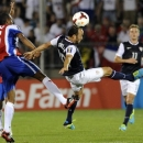 United States' Landon Donovan, center, fights for a ball with Costa Rica's Junior Diaz, left during the second half of a CONCACAF Gold Cup soccer match Tuesday, July 16, 2013, in East Hartford, Conn. The United States won the match 1-0. (AP Photo/Fred Beckham)