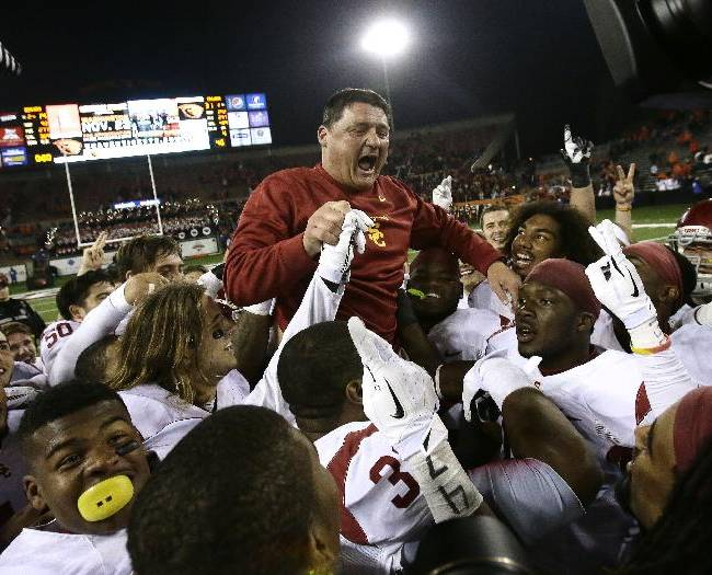 Southern California interim football coach Ed Orgeron celebrates with his team after winning an NCAA college football game against Oregon State in Corvallis, Ore., Friday, Nov. 1, 2013. USC won 31-14