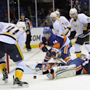 New York Islanders' Thomas Hickey (14) defends against Nashville Predators' Taylor Beck (41) after Islanders goalie Kevin Poulin (60) falls to the ice in the third period of an NHL hockey game on Tuesday, Nov. 12, 2013, in Uniondale, N.Y. The Islanders wo