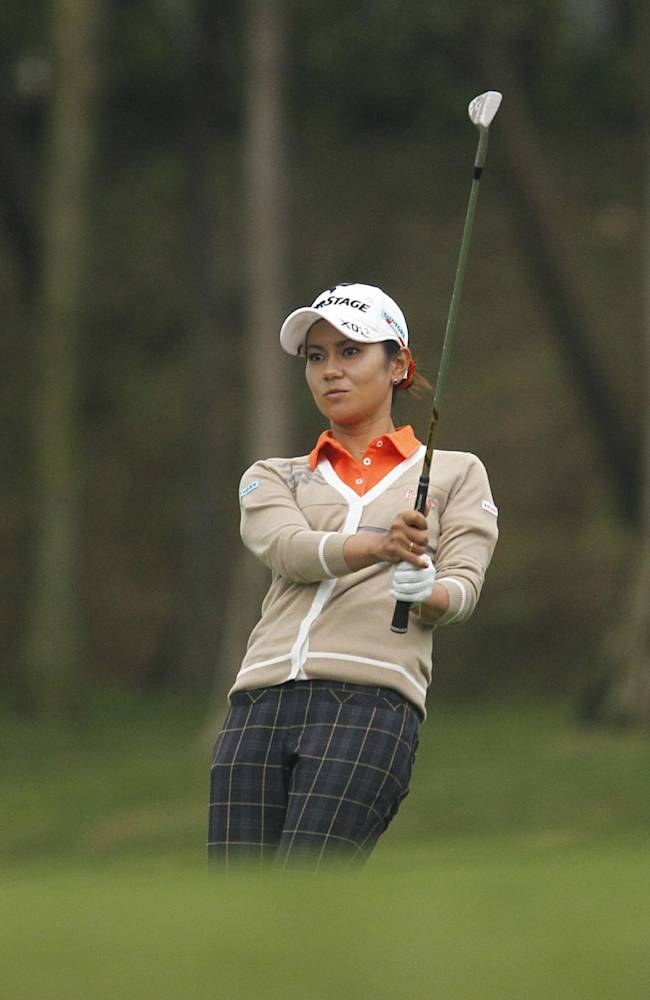Ai Miyazato of Japan reacts to a close shot on the 18th green during the first day of the Sunrise LPGA Taiwan Championship tournament at the Sunrise Golf & Country Club in Yangmei, north eastern Taiwan, Thursday, Oct. 24, 2013