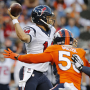 Houston Texans quarterback Ryan Fitzpatrick (14) is hurried by Denver Broncos outside linebacker Von Miller (58) during an NFL preseason football game, Saturday, Aug. 23, 2014, in Denver The Associated Press
