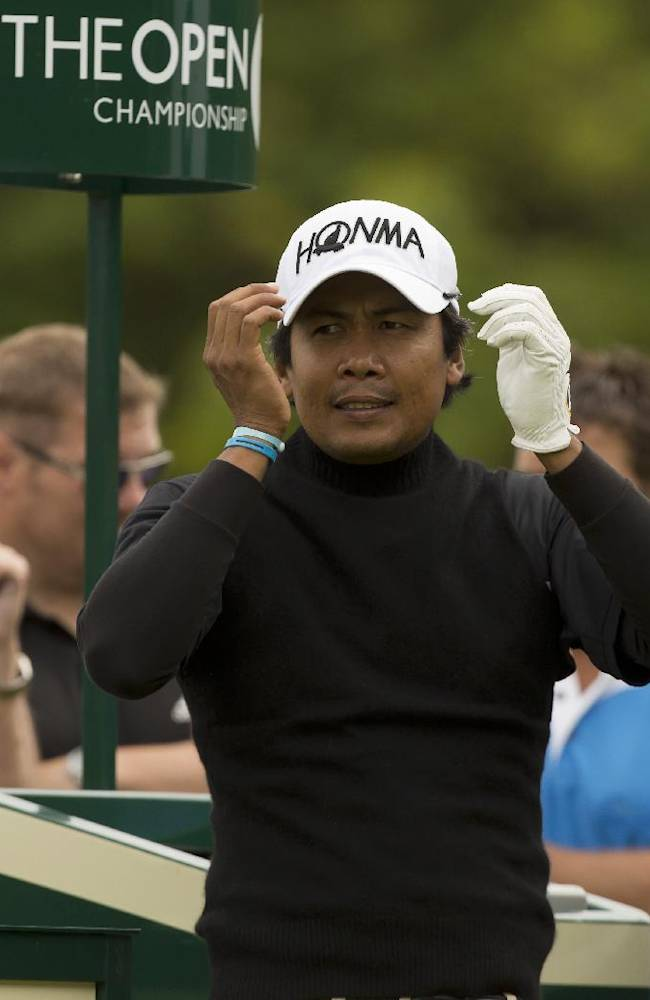 Juvic Pagunsan of the Philippines watches a shot off the fifth tee during a practice round at Royal Liverpool Golf Club prior to the start of the British Open Golf Championship, in Hoylake, England, Monday, July 14, 2014. The 2014 Open Championship starts on Thursday, July 17