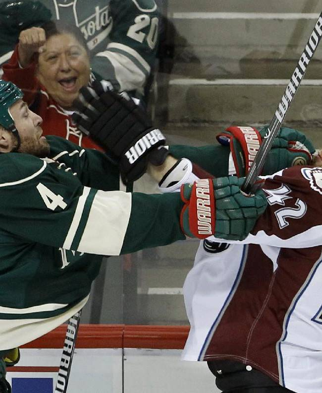 Minnesota Wild defenseman Clayton Stoner (4) shoves Colorado Avalanche center Brad Malone (42) during the first period of Game 3 of an NHL hockey first-round playoff series in St. Paul, Minn., Monday, April 21, 2014