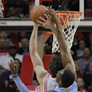 Denver Nuggets forward Quincy Miller blocks the shot of Houston Rockets center Omer Asik during an NBA basketball game in Houston on Sunday, April 6, 2014 The Associated Press