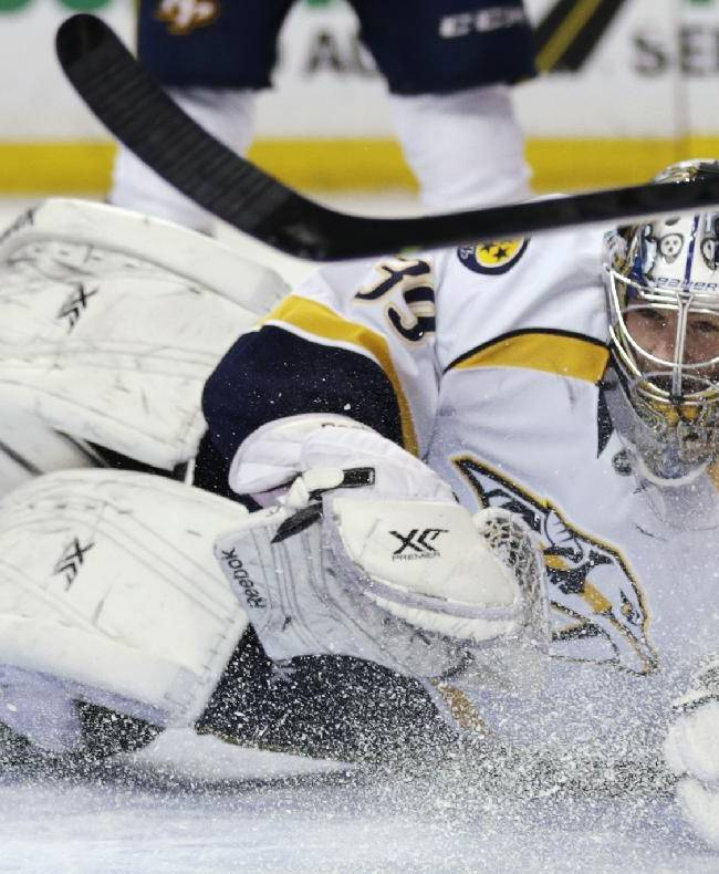 Nashville Predators goalie Marek Mazanec loses his stick as he drops to the ice on a save against the Boston Bruins during the second period of an NHL hockey game, Thursday, Jan. 2, 2014, in Boston