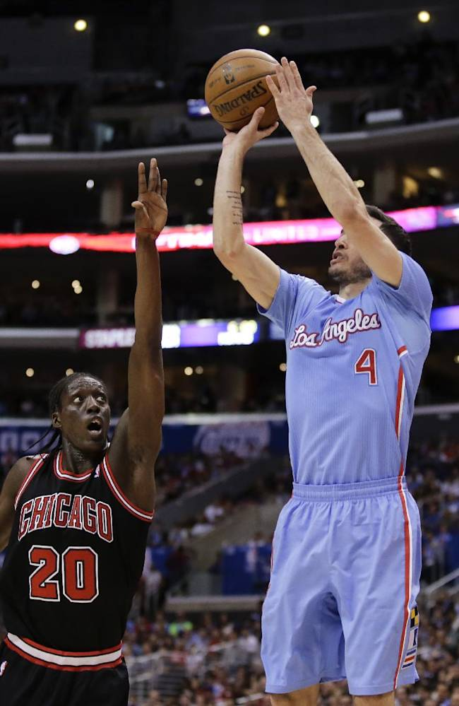 Los Angeles Clippers guard J.J. Redick (4) shoots over Chicago Bulls forward Tony Snell during the first half of an NBA basketball game in Los Angeles, Sunday, Nov. 24, 2013