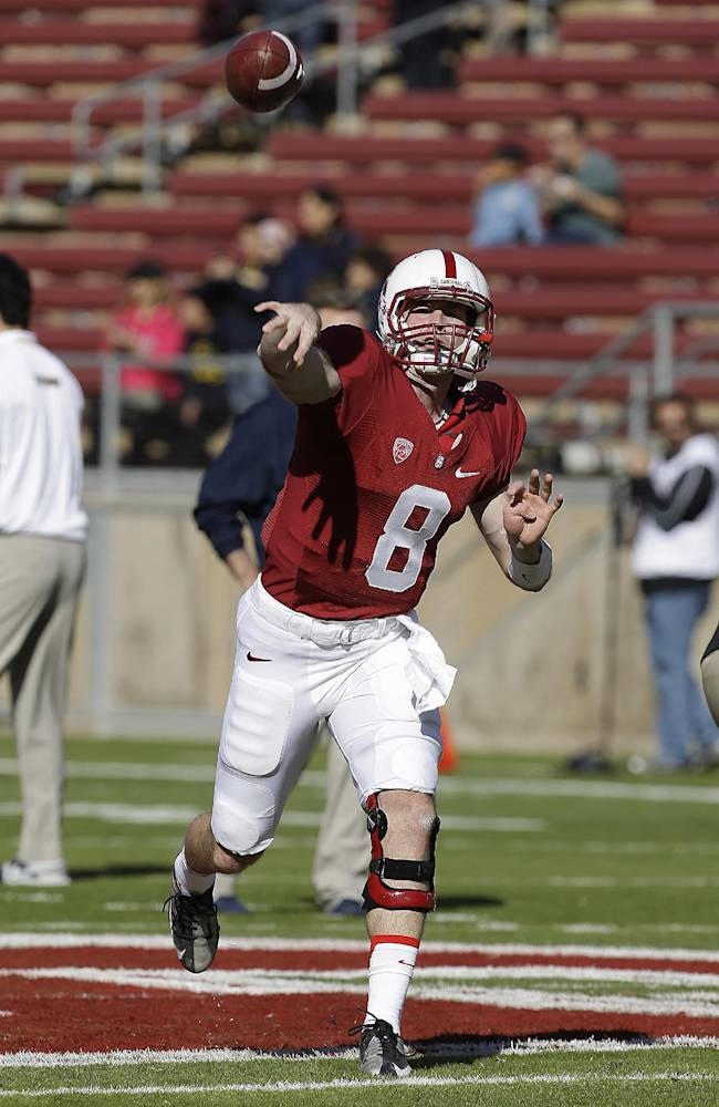 Stanford quarterback Kevin Hogan (8) warm-ups before the start of an NCAA college football game against California in Stanford, Calif., Saturday, Nov. 23, 2013