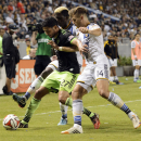 Seattle Sounders midfielder Lamar Neagle, left, attempts to hold off Los Angeles Galaxy defender Robbie Rogers, right, and Los Angeles Galaxy forward Gyasi Zardes, center, during the second half of an MLS soccer match in Carson, Calif., Sunday, Oct. 19, 2