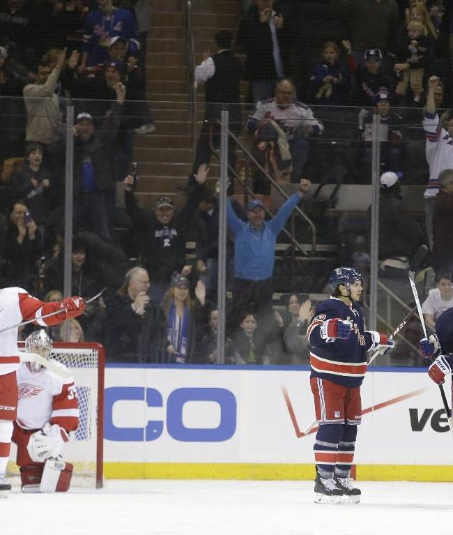 Detroit Red Wings' Brendan Smith (2), goalie Jimmy Howard (35) and Joakim Andersson (18) watch as the New York Rangers celebrate a goal by Brian Boyle (22) during the first period of an NHL hockey game on Sunday, March 9, 2014, in New York